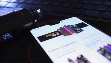 VapeApe Online Vape Shop on mobile with VooPoo e-cigarette and Keyboard Logi